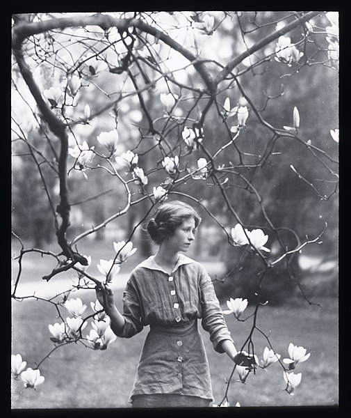 Edna St. Vincent Millay among a flowering tree