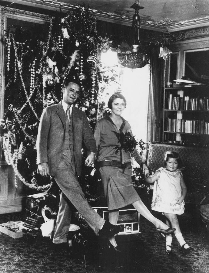 F Scott Fitzgerald, and Zelda Fitzgerald, Scottie Fitzgerald in front of their Christmas tree